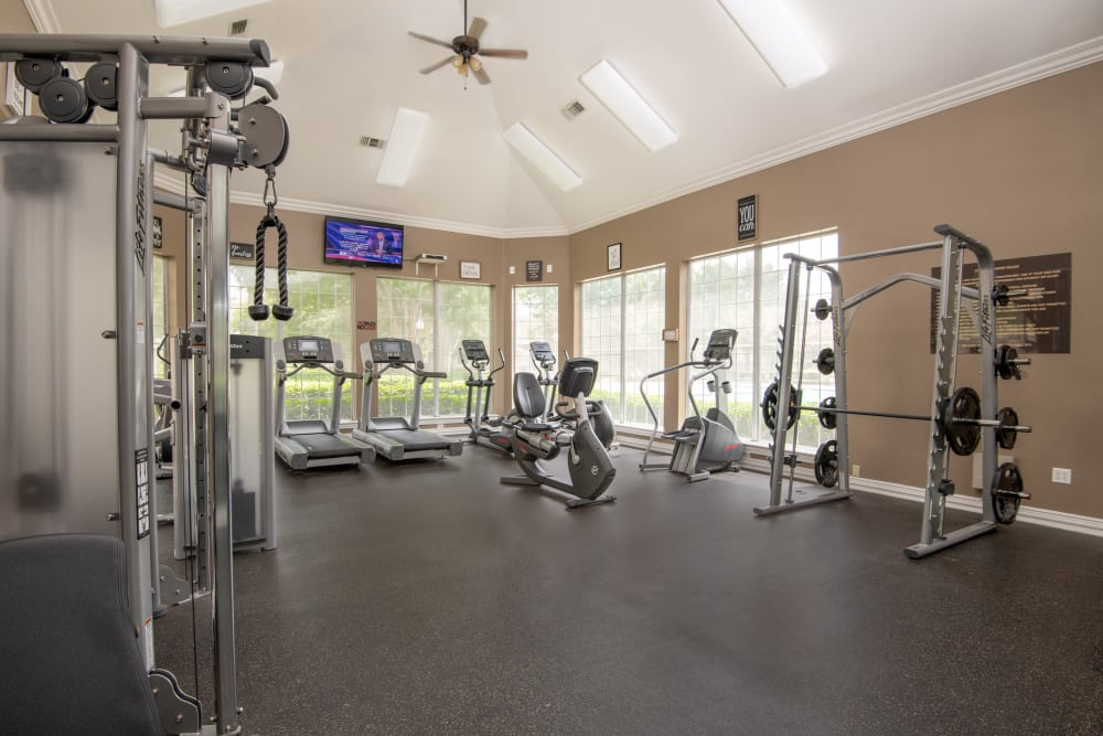 Well equipped fitness center at Ballantyne Apartments in Lewisville, Texas