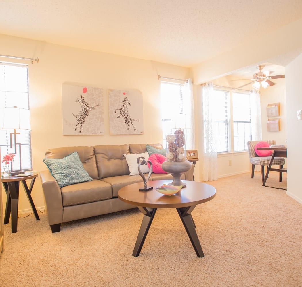 Well lit living room at Creekwood Apartments in Tulsa, Oklahoma