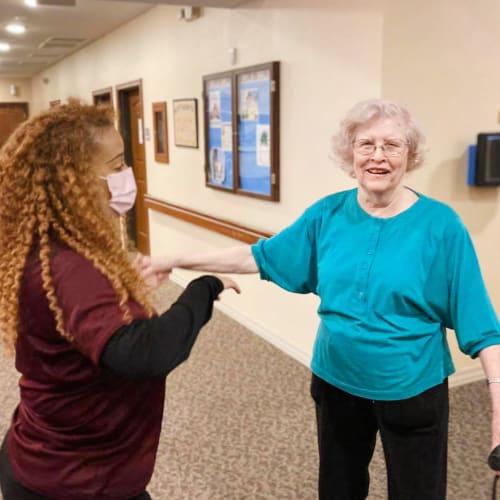 Resident and caretaker dancing of Oxford Glen Memory Care at Carrollton in Carrollton, Texas
