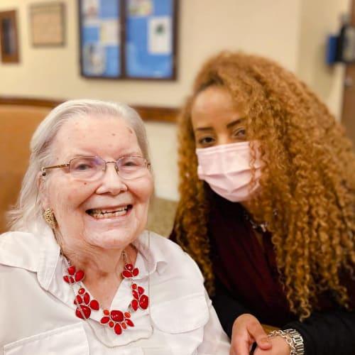 Resident with caretaker at Oxford Glen Memory Care at Carrollton in Carrollton, Texas