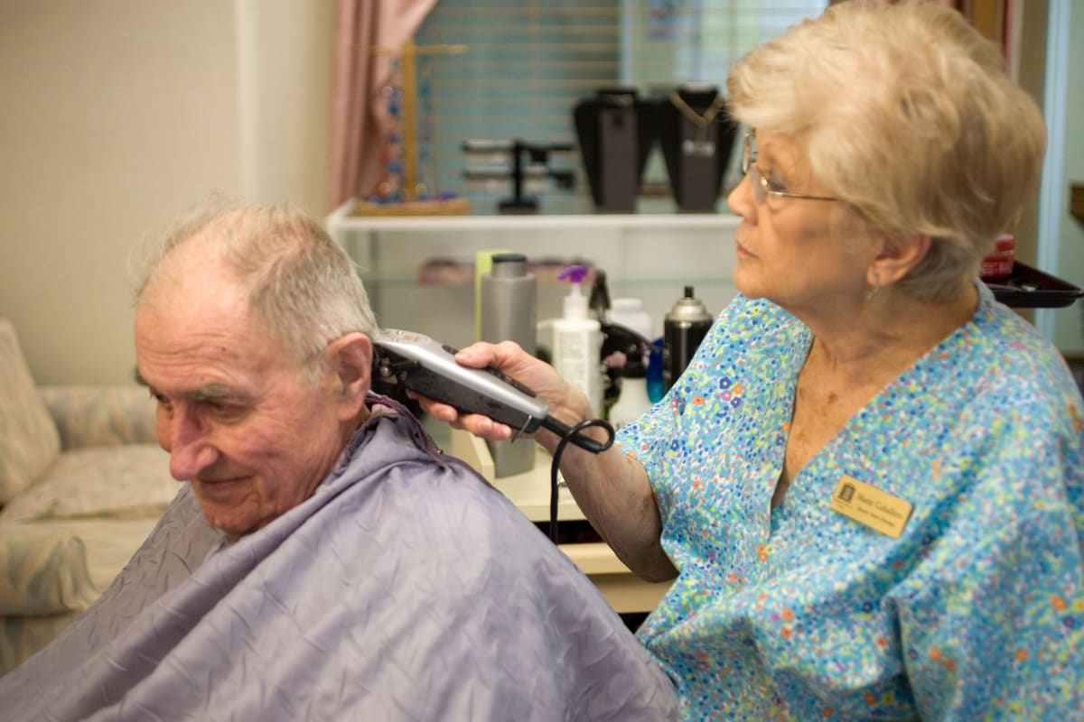 Resident getting a haircut at Parsons House Austin in Austin, Texas