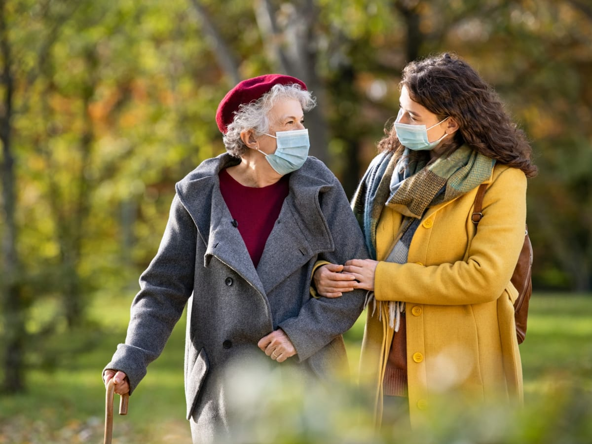 Resident and daughter taking a walk with a mask on near Worthington Manor in Conroe, Texas