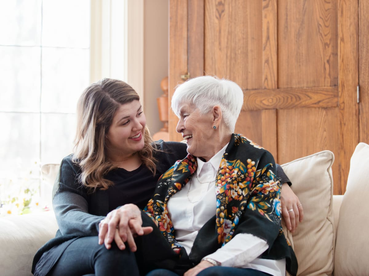 A resident and a staff member chatting at Worthington Manor in Conroe, Texas.