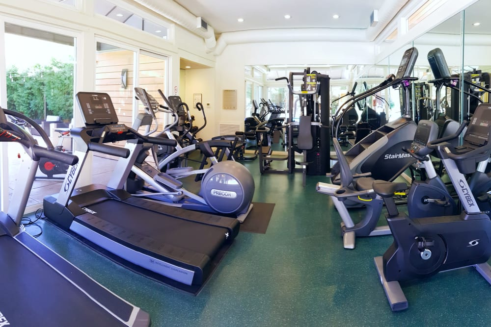 Fully equipped fitness center at Brookdale Apartments in San Jose, California