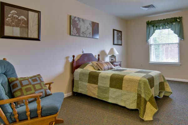 Assisted living apartment bedroom at South Pointe Senior Living in Washington, Missouri
