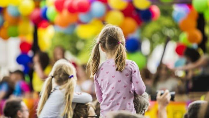 Children watching a parade.