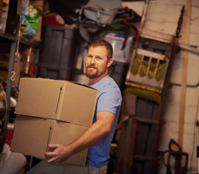 Man storing some boxes at Cliffdale Safe Storage in Fayetteville, North Carolina