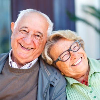 Resident couple sitting outside at York Gardens in Edina, Minnesota