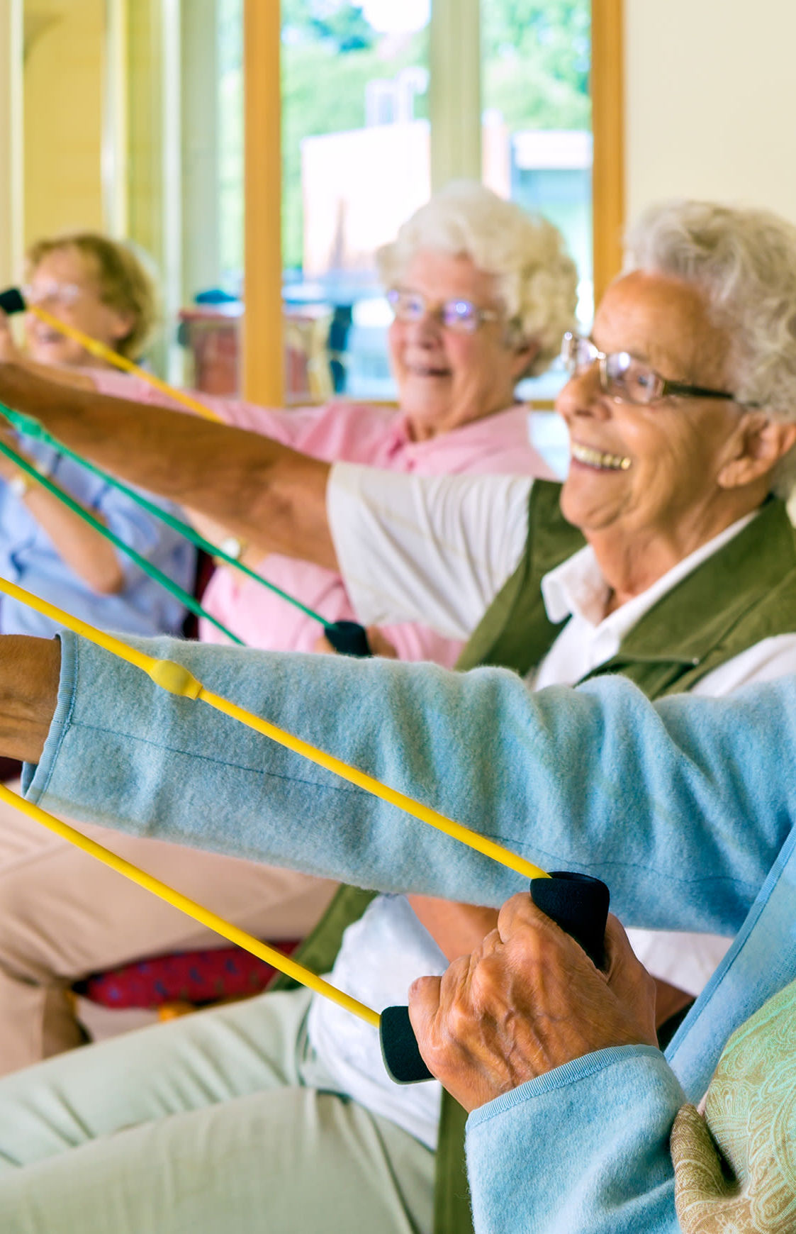 Residents exercising with rubber bands at The Reserve at Thousand Oaks in Thousand Oaks, California