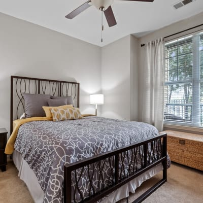Well lit bedroom with a ceiling fan to keep you cool at Sofi Lyndhurst in Lyndhurst, New Jersey
