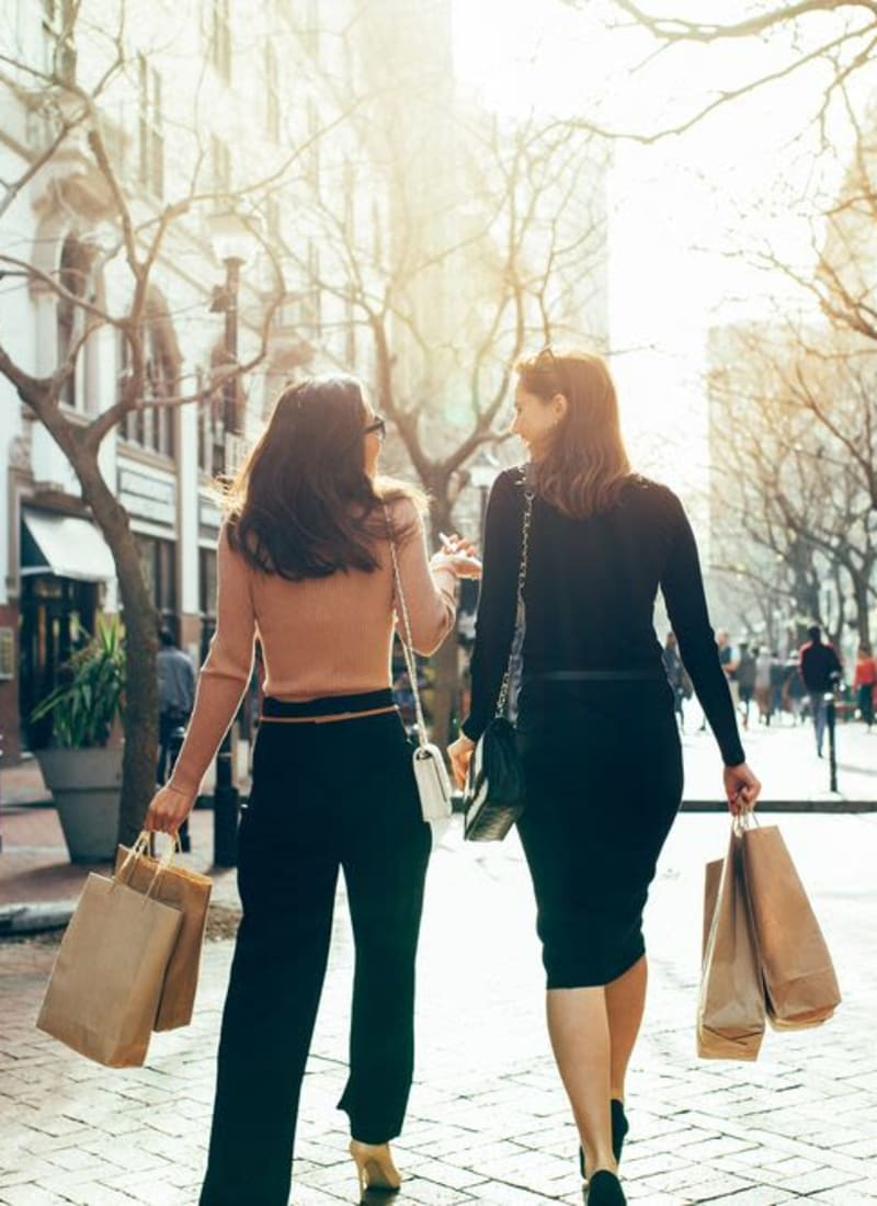 Residents walking around with shopping bags near Marquis at Tanglewood in Houston, Texas
