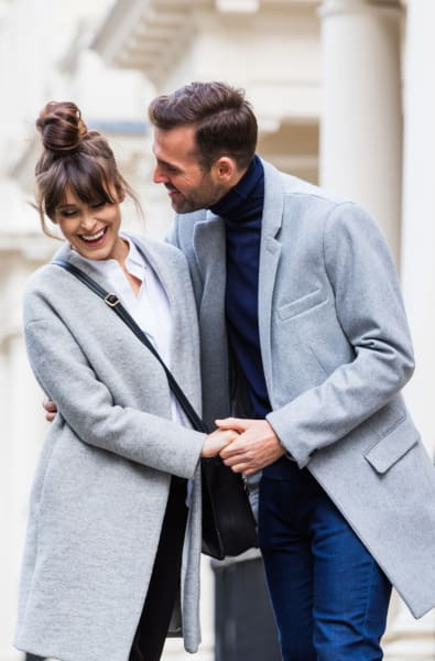 Couple walking around in New Rochelle, New York near Skyline New Rochelle