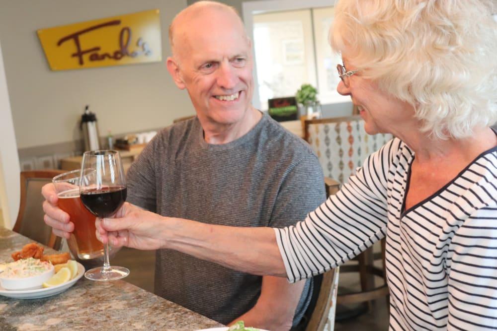 Two residents enjoying drinks at The Springs at Sherwood in Sherwood, Oregon