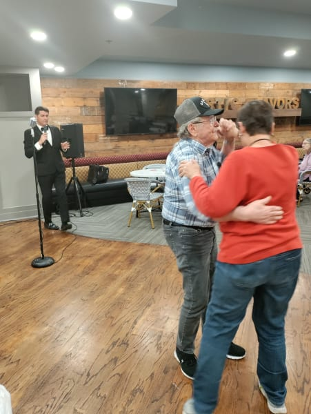 A charming Park Central couple takes to the dance floor while a local musician performs.