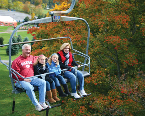 Family on a chairlift near Reserve Pointe Apartments in Canandaigua, New York
