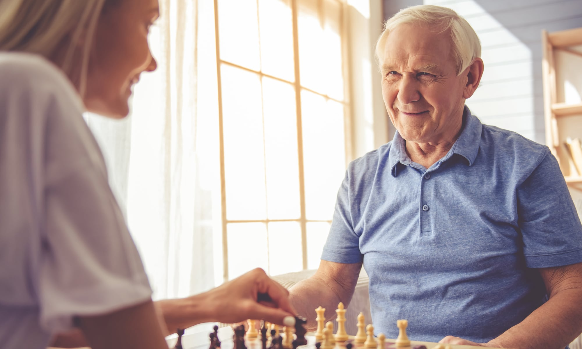 Residents playing chess at a Seasons Living community