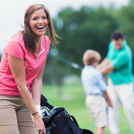 A woman playing golf near Hunt Club Apartments in Cockeysville, Maryland