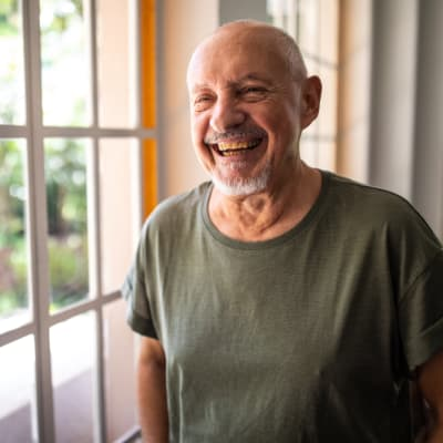 Man smiling at RockBrook Memory Care in Lewisville, Texas