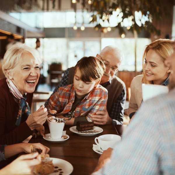 Family enjoying a birthday celebration at their favorite restaurant near Vistara at SanTan Village in Gilbert, Arizona