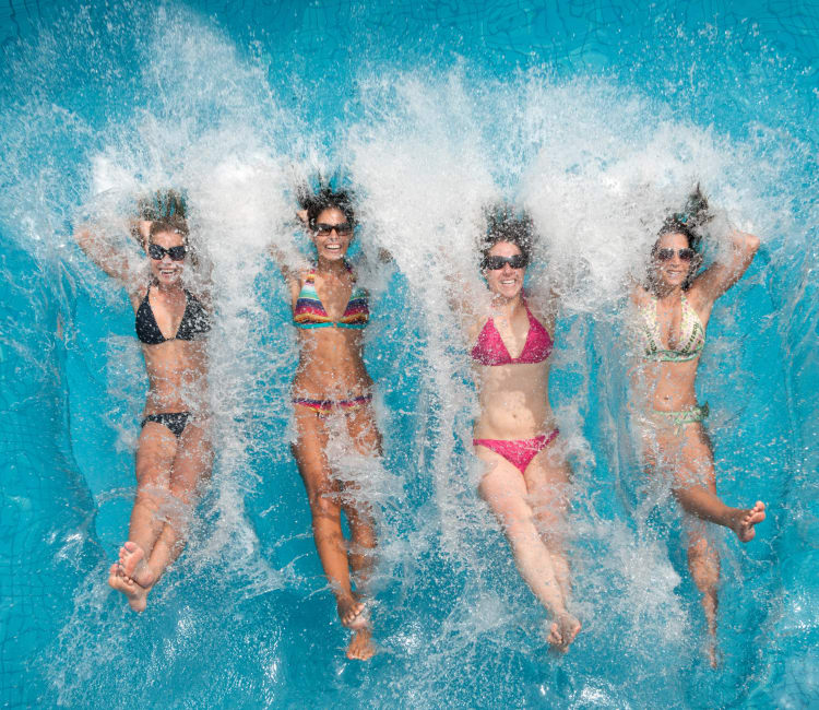 Resident lady friends making a splash in the pool at Alterra Apartments in Las Vegas, Nevada