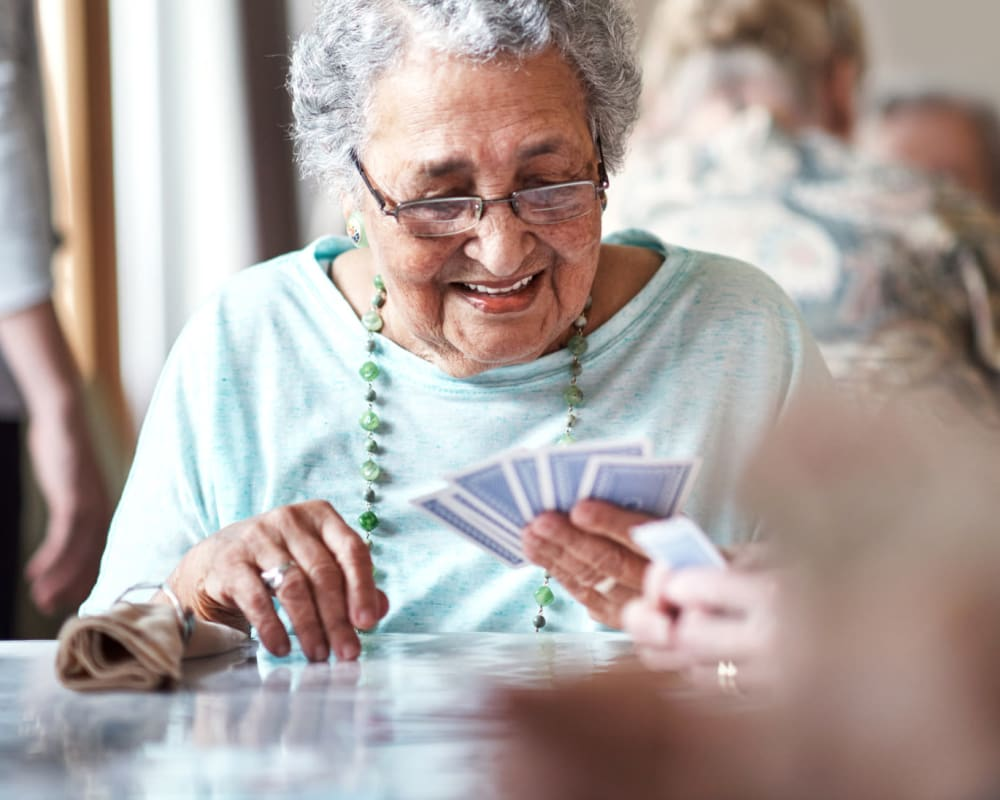 A resident playing cards at Randall Residence of Sterling Heights in Sterling Heights, Michigan