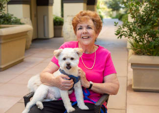 Resident and pet at senior living in Oceanside