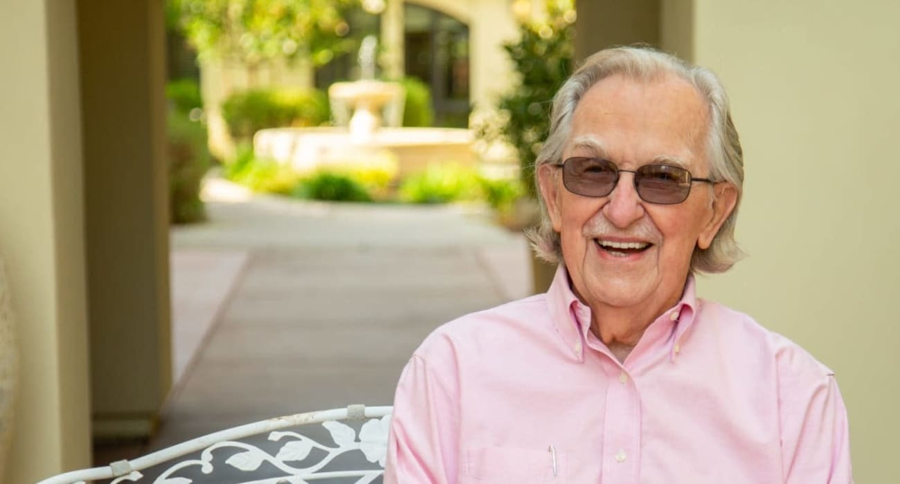 A resident sitting outside at Merrill Gardens at ChampionsGate in ChampionsGate, Florida.