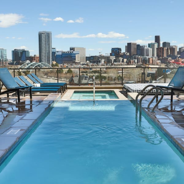 Relaxing pool with a beautiful view of downtown The Alcott in Denver, Colorado