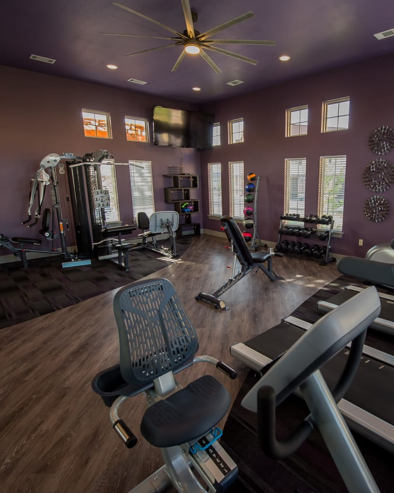 Fully-equipped fitness center at Watercress Apartments in Maize, Kansas