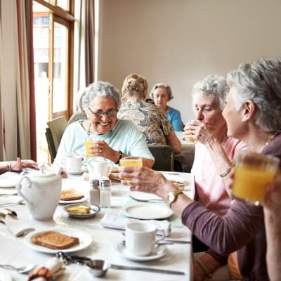 Women dining together at The Sanctuary at Brooklyn Center in Brooklyn Center, Minnesota