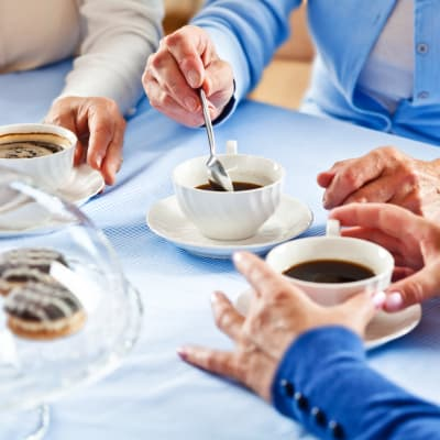 Table top with residents stirring their coffee at York Gardens in Edina, Minnesota