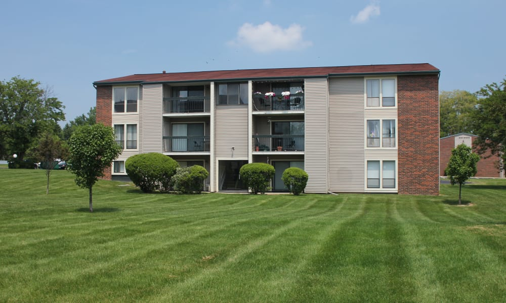 Lush Green Space at Fairway Trails Apartments in Ypsilanti, MI