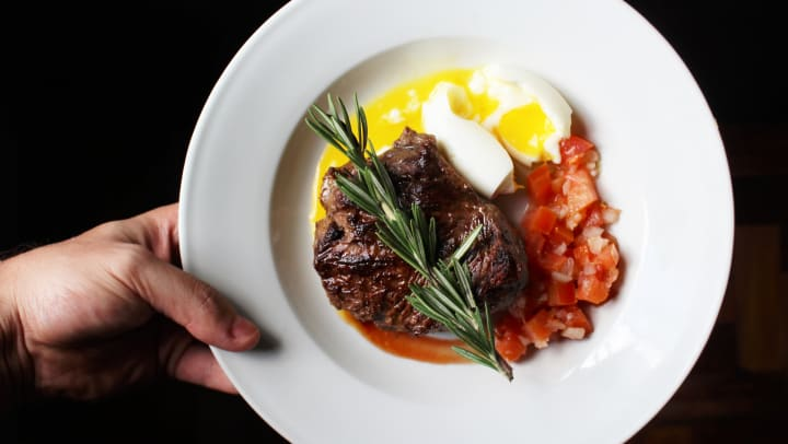 Plated steak from a steakhouse near Mirador & Stovall at River City Apartments in Jacksonville, Florida