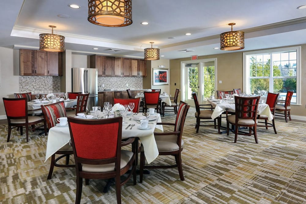Luxurious dining area with hardwood flooring and accents at Maplewood at Stony Hill in Bethel, Connecticut