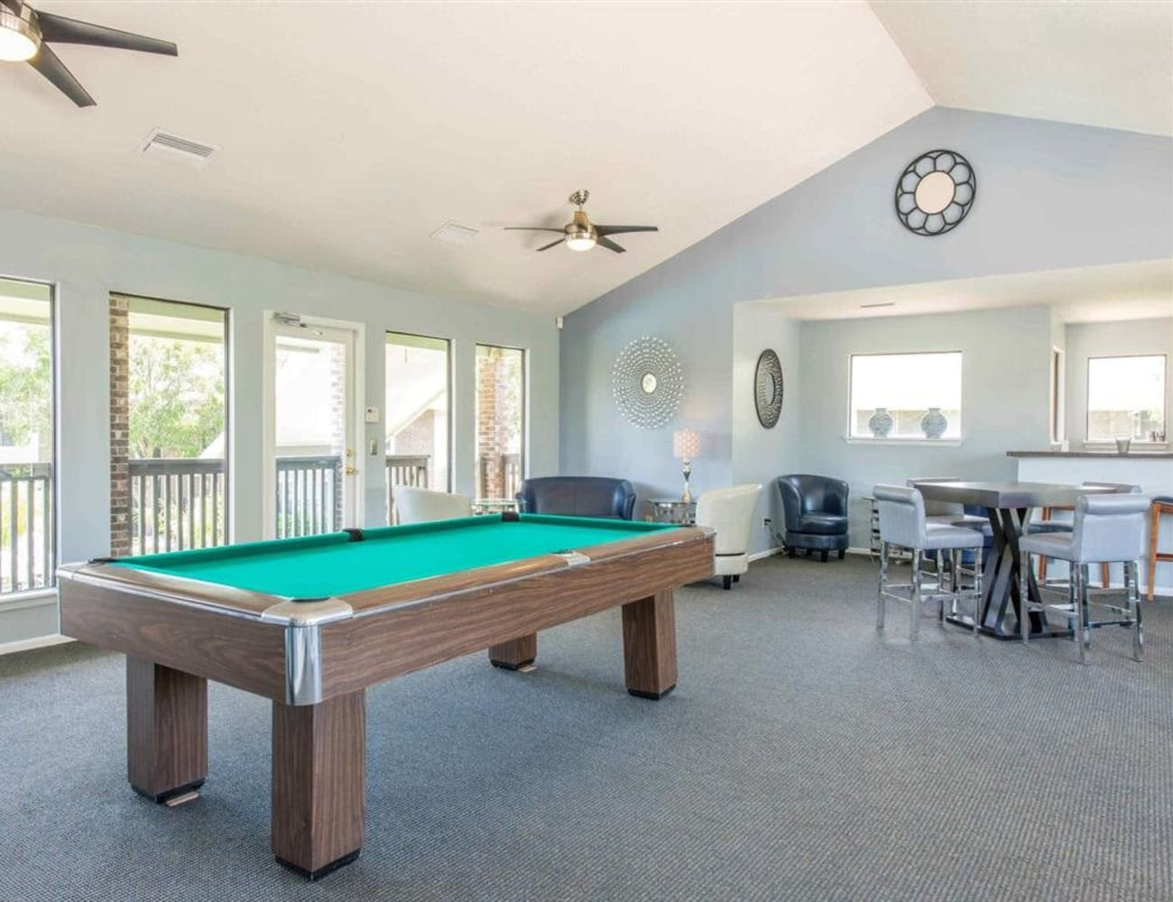 Resident clubhouse with billiards table and more at Compass in Melbourne, Florida