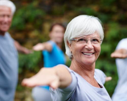Older woman doing yoga at Avenida Partners, LLC in Newport Beach