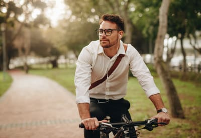 Resident biking to work near The Harlowe in Charlotte, North Carolina