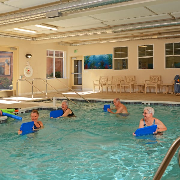 Residents exercising in the pool at Quail Park at Browns Point in Tacoma, Washington
