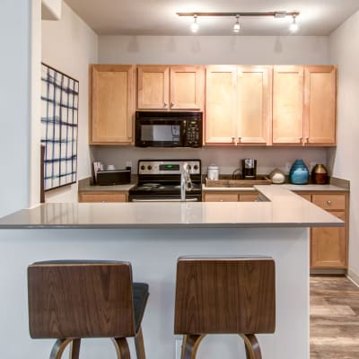 Modern kitchen with quartz countertops in a model home at Sofi at Forest Heights in Portland, Oregon
