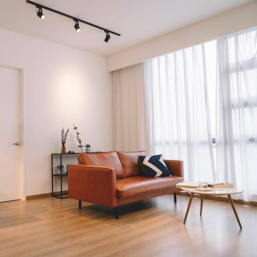 Beautiful hardwood flooring in a model home's living area at El Potrero Apartments in Bakersfield, California