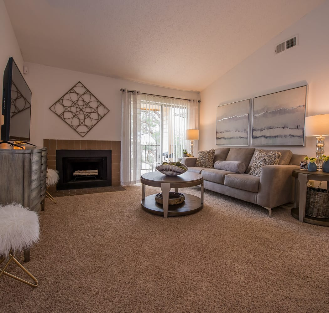 Cozy living room with plush carpet at Windsail Apartments in Tulsa, Oklahoma