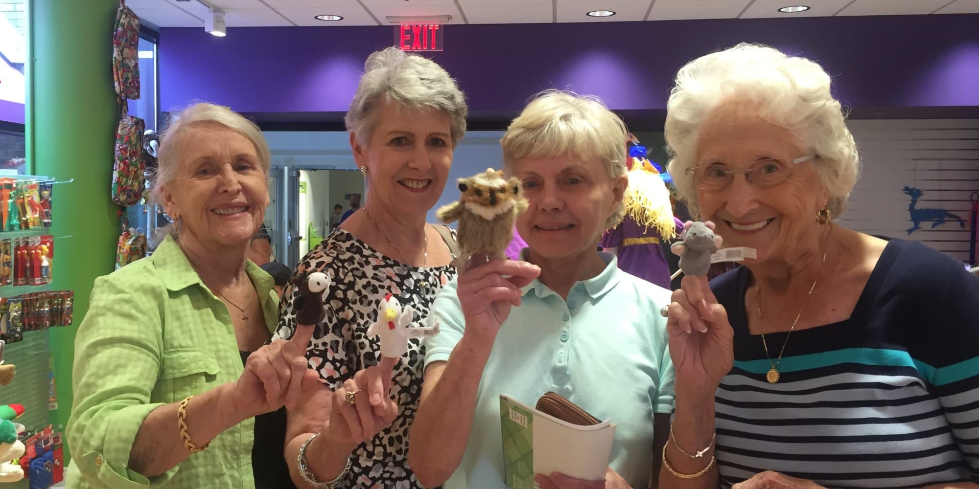 Residents of Cedarview Gracious Retirement Living playing with finger puppets in Woodstock, Ontario