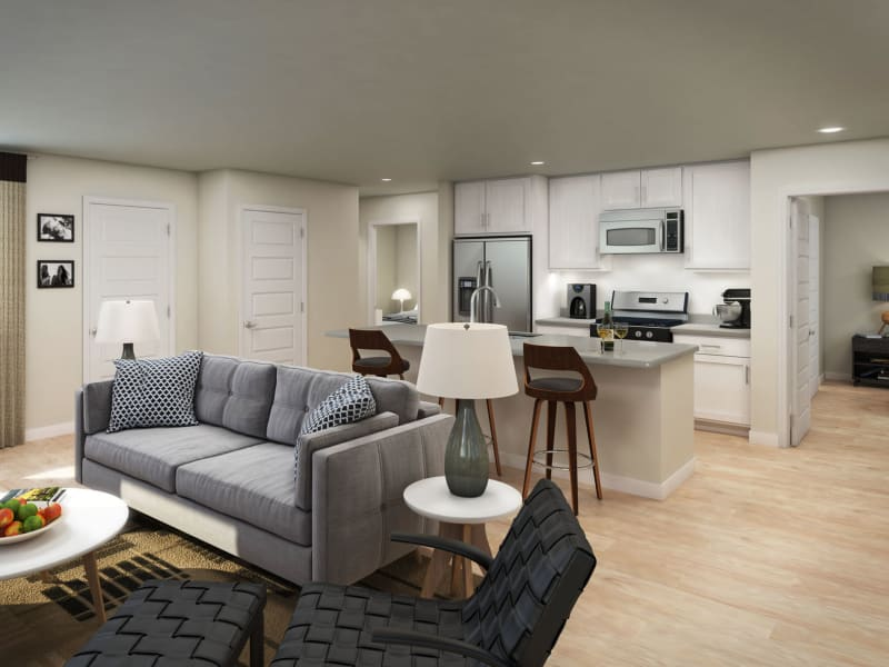 Well-furnished living area with hardwood flooring throughout in a model home interior rendering at Peralta Vista in Mesa, Arizona