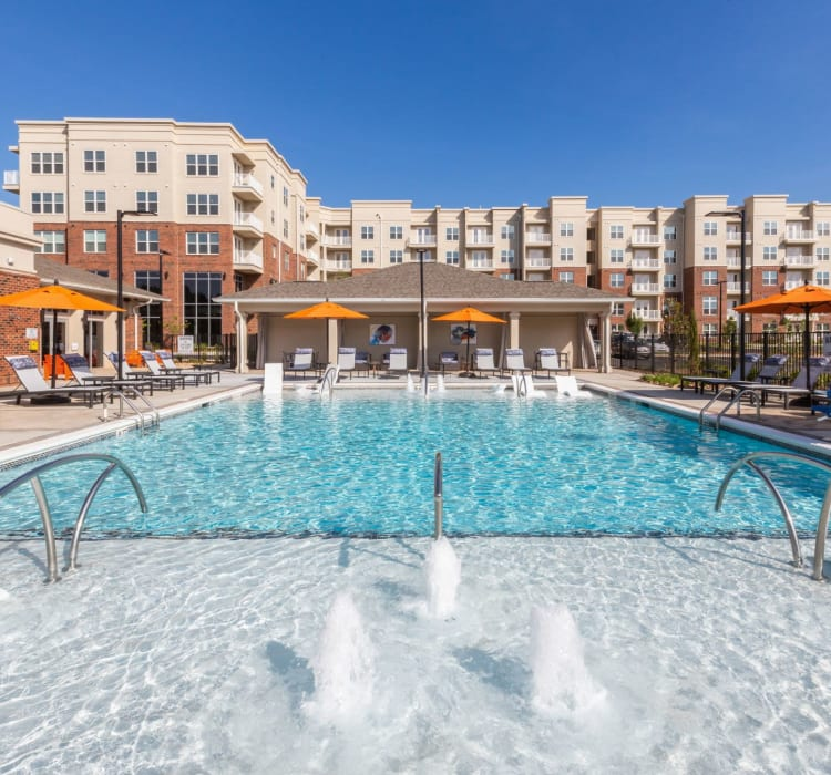 Huge resort style pool where residents can relax, swim, and enjoy their free time at 8 Metro Station in Charlotte, North Carolina