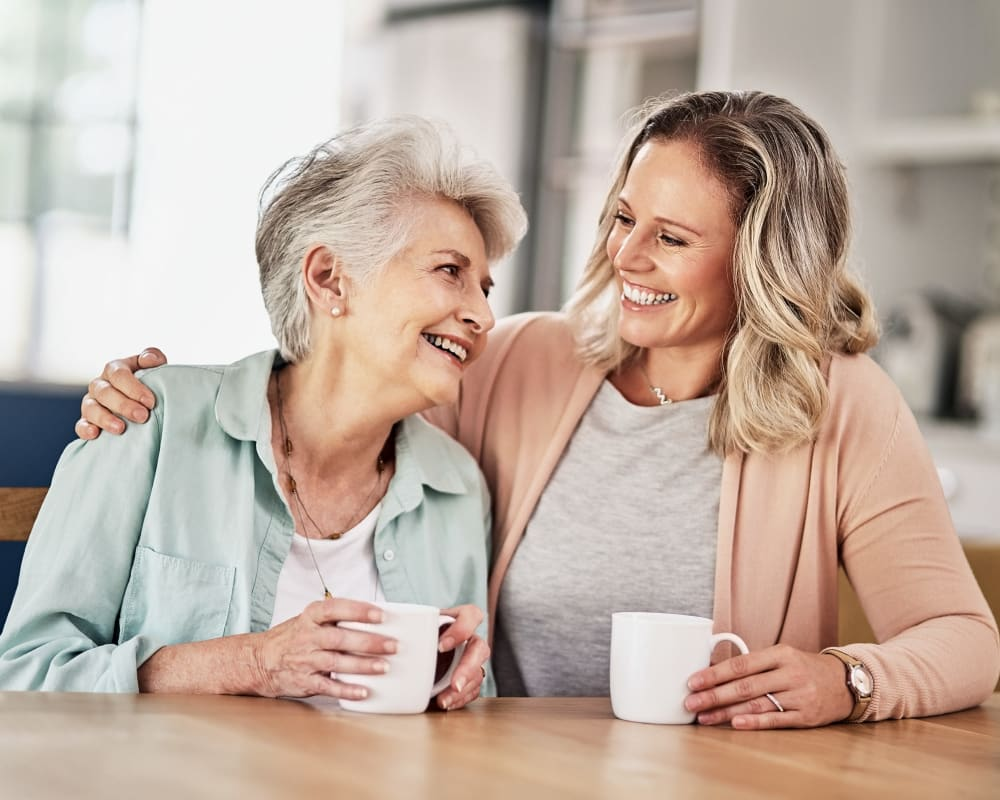 Resident and daughter share a cup of coffee at Liberty Court in Dixon, Illinois.