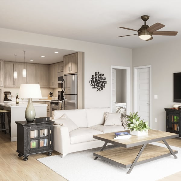 In unit view of kitchen and living room at Estia Surprise Farms in Surprise, Arizona