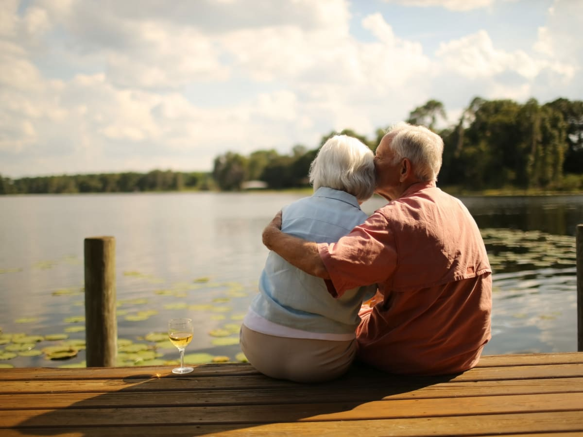 A resident couple sitting on a dock near Worthington Manor in Conroe, Texas.