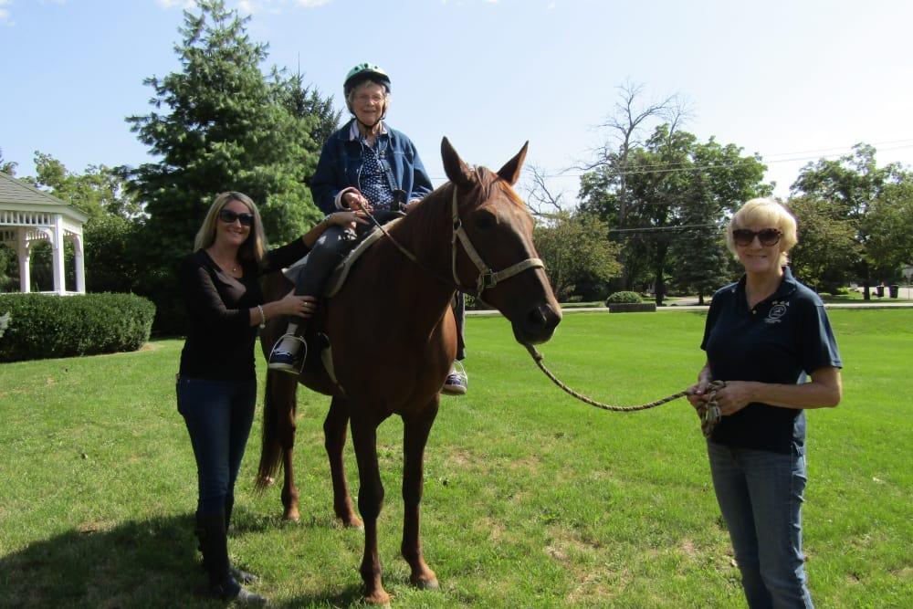 senior riding a horse