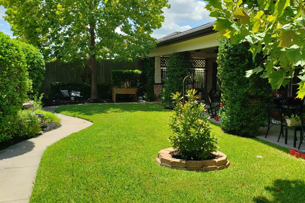 Backyard porch and garden at Autumn Grove Cottage at Champions in Spring, Texas