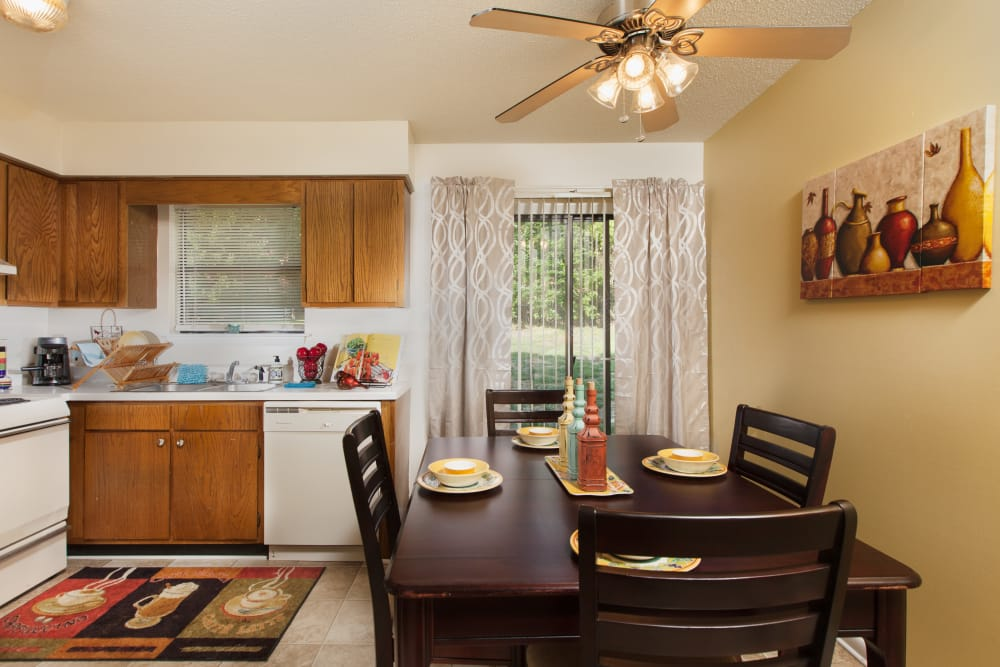 A view of the kitchen and dining area at Cross Creek Cove Apartments & Townhomes